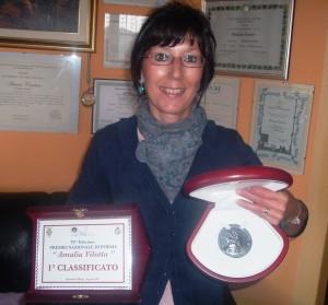 Aurora Cantini con la moneta Leoncavallo d'argento al concorso di poesia di Montalto Uffugo